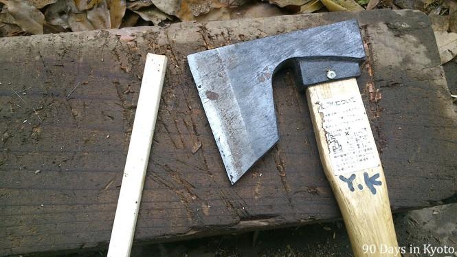 Before - cutting a takegushi (竹串 - bamboo skewer) with a nata (鉈).